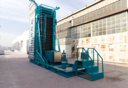 Container unloaders and loaders